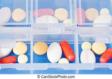Container with drugs - Open dosage plastic container full of...
