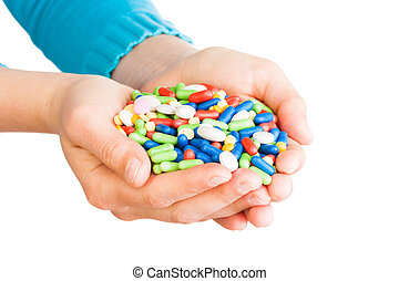 Hand full of pills - Two hands full of large pile of...