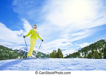 I love mountain ski - Happy young woman skier stand on top...