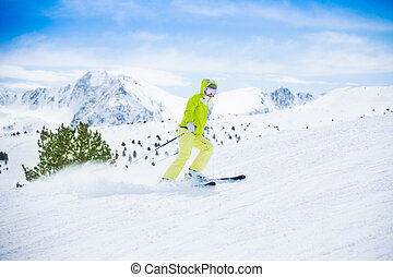 Skiing fast is fun - Yong happy woman ski downhill with snow...