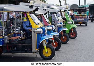 tuk tuk taxis in bangkok - thailands famous open air taxis...