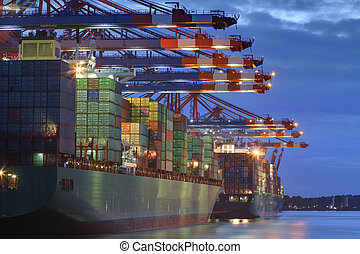 Container Terminal - Container ship in the harbor of Hamburg...