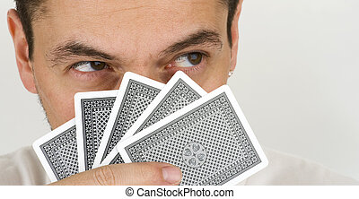 poker face - gambler playing cards with poker face