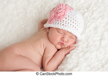 Newborn Baby Girl Wearing a Crocheted Hat - An 8 day old...