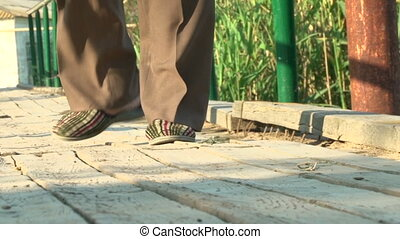 Mens feet in Slippers on the street