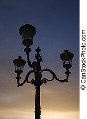 Streetlamp in Rome - Streetlamp with sunset sky in...