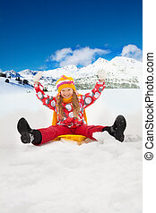 Snow day - happy child - Smiling, smiling girl sitting on...