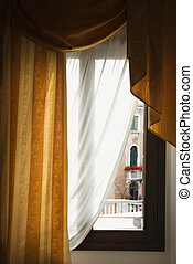 Window with drapes. - Window with drapes in Venice, Italy.