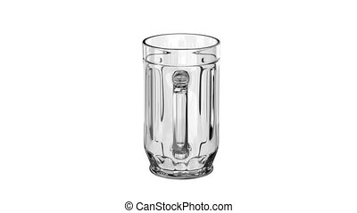 Empty beer mug rotates on a white background