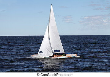 sailing race - sailing yacht during the race side view