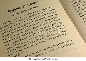 Hindi Book - Opened Hindi book with calligraphic sanskrit...
