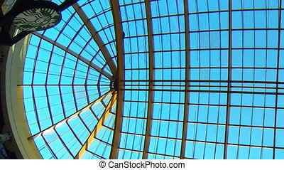 Glass ceiling - Glass oval ceiling. Blue sky.