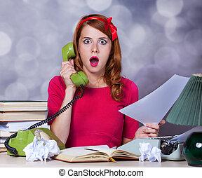 Woman at typewriter on telephone