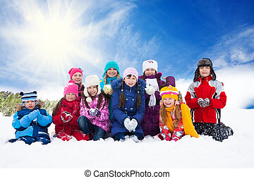 Large group of happy kids throwing snow - Group of three...