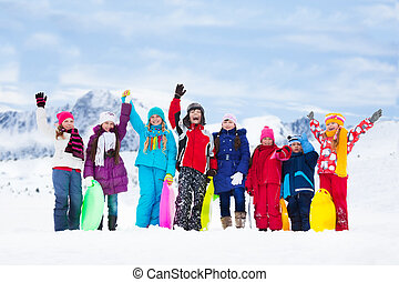 Many kids outside in winter - Row of large group of kids,...