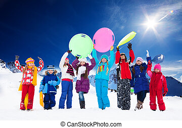 Many kids and snow activities - Row of large group of kids,...