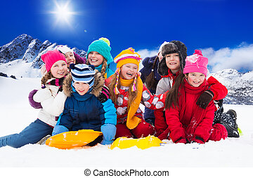 Group of kids on snow day - Group of kids together hugging...