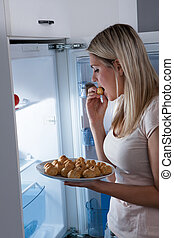 Young Woman Eating Cookies