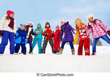 Large group of kids together on snow day