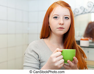 teenager with cup of medicine gargling - red-haired teenager...