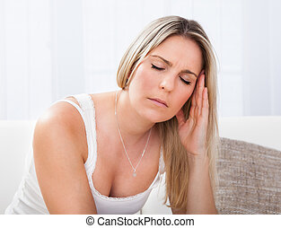Portrait of woman with migraine - Woman with a migraine...