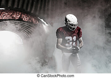 Football Player - Football player, leaving a smoky tunnel,...