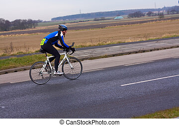 cycle race - man racing on a bicycle
