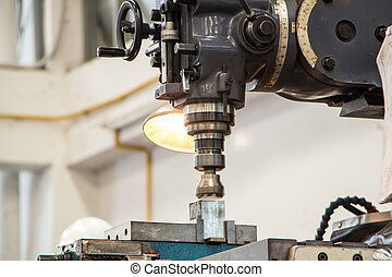 Milling machine - Shot of an old milling machine in a...