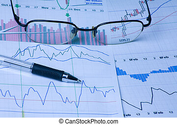 stock markey - stockmarket charts pen and glasses