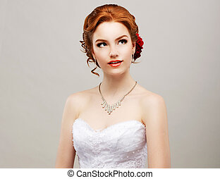 Sentimentality. Romantic Red Hair Woman with Flower in her...