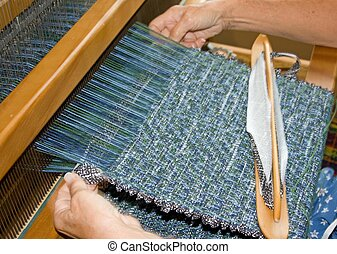 weaving - At work weaving at a heritage village in Port...