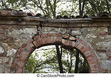 Outdoor stone archway. - Dilapidated stone archway with...