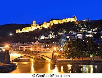 Capital of Georgia - Tbilisi at night against the dark blue...