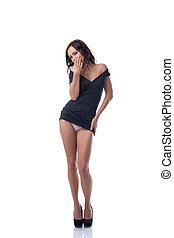 Seductive slim model posing in black tunic - Image of...