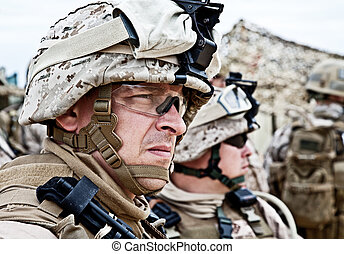 marine - US marine in the MARPAT uniform and protective...