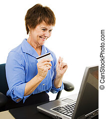 Mature Woman Internet Shopping - Mature woman uses her...