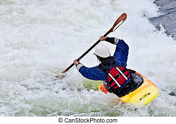 active female kayaker - an active female kayaker rolling and...