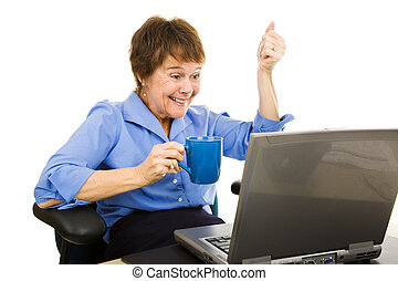 Exciting News Online - Woman drinking coffee and reading...
