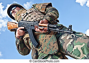 soldier with ak-47 - soldier in bulletproof vest with ak-47...