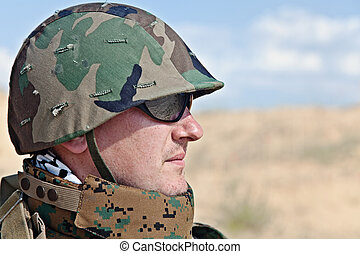 army soldier - soldier in the military helmet half-turned to...