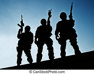 S.W.A.T. team - Silhouettes of S.W.A.T. officers holding...