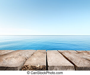 Blue sea and wooden pier - Wooden pier stretching into the...
