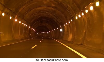 lonely road tunnel - subjective shot driving at road in...