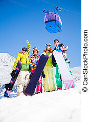Snowboard mates on ski resort - Happy friends men and women...