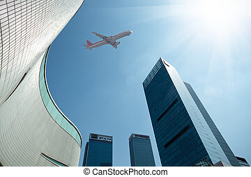 airplane in business center - airplane with modern building...
