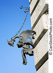 Gargoyle chained to wall. - Winged gargoyle chained to wall.