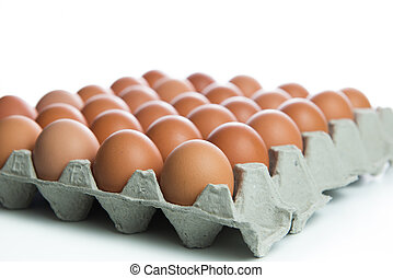 Brown eggs in carton box on white background