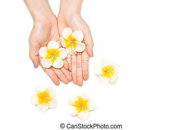 Beautiful woman hand with spa candle on white background