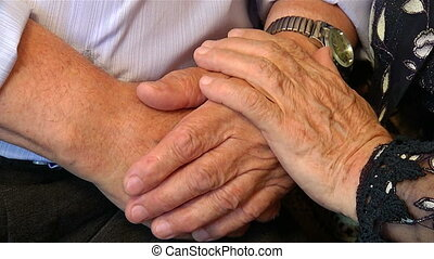 Hands of older people to stay