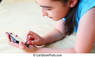 Little girl playing on smart phone